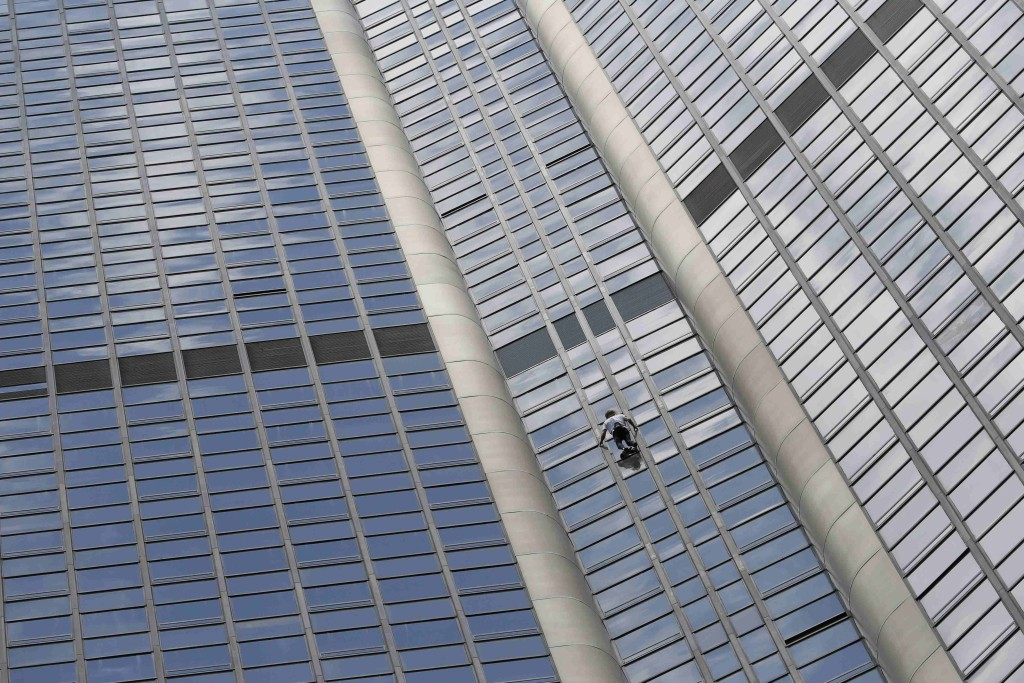 "French climber Alain Robert, also known as ""Spiderman"", scales the Tour Montparnasse, a 210-metre (689 ft) building in central Pairs in tribute to Nepal earthquake victims"